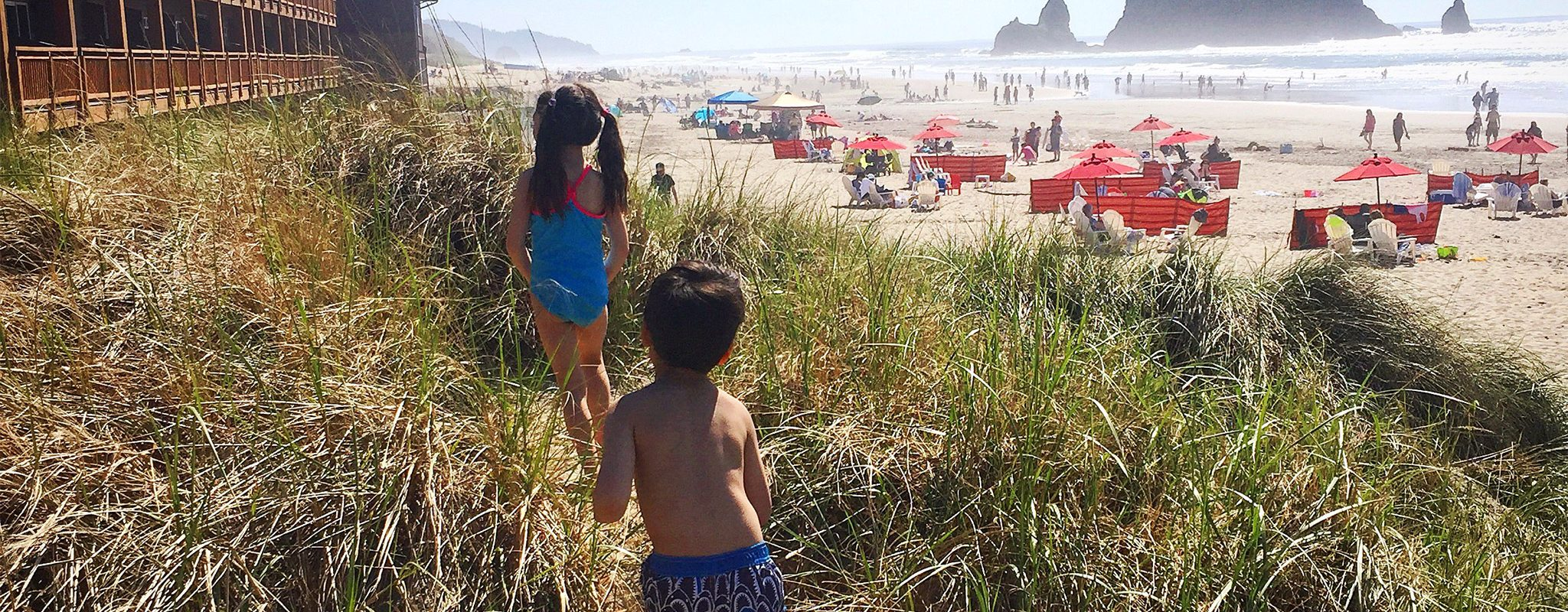 Kids playing in the dunes at Cannon Beach.