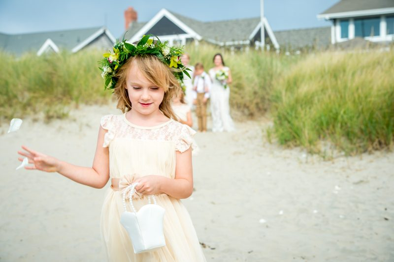 Flower girl on the beach