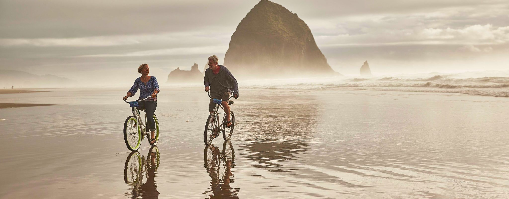 Ride bikes on the Oregon coast.