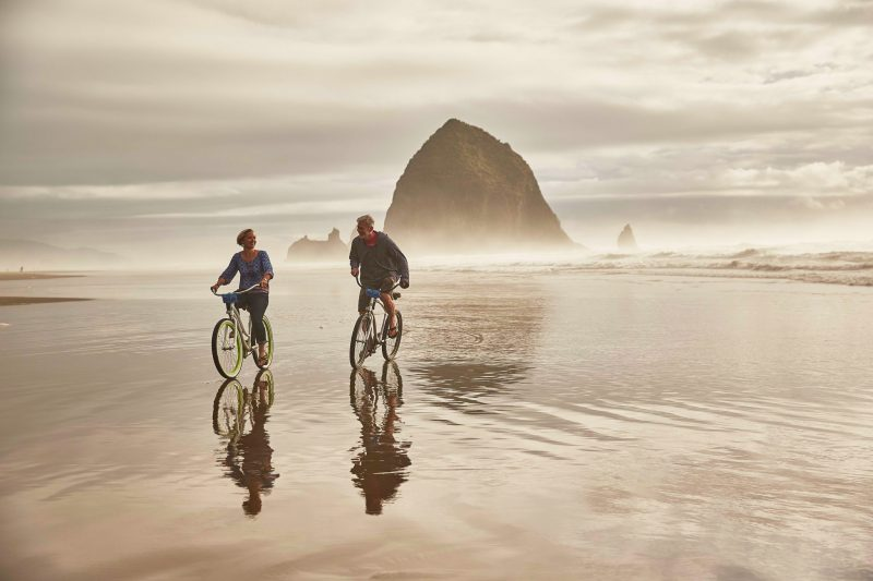Riding bikes on the beach.